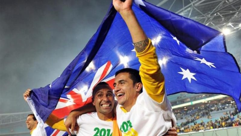Archie Thompson (L) and Tim Cahill celebrate win which sees Australia into World Cup finals [EPA]