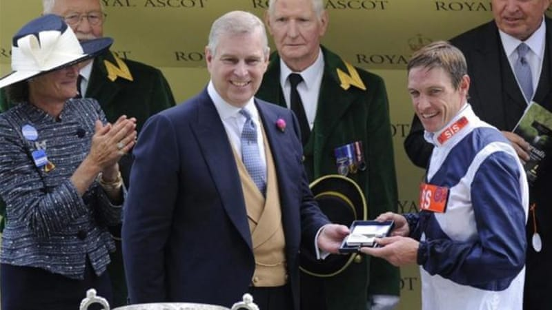 Irish jockey Richard Hughes (R) is presented with award by Britain's Prince Andrew, The Duke of York (C) [EPA]