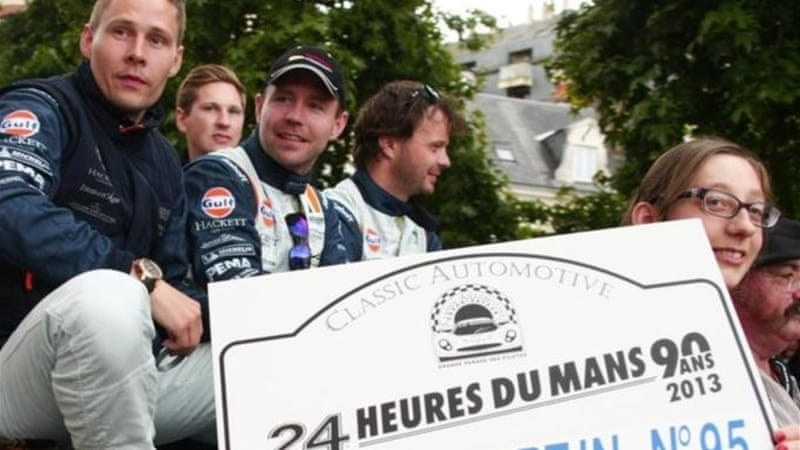Simonsen (far left) attends parade on eve of 90th 24-hour Le Mans endurance race in western France [AP]