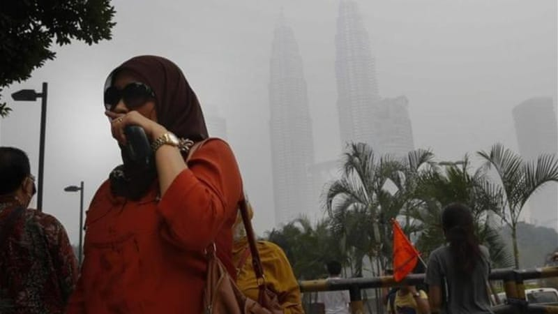"In capital Kuala Lumpur, the pollution index neared the ""very unhealthy"" 200 level for the first time [AP]"
