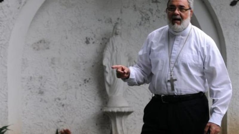 Bishop Romulo Emiliani helped broker a truce between two deadly gangs in Honduras [AFP]