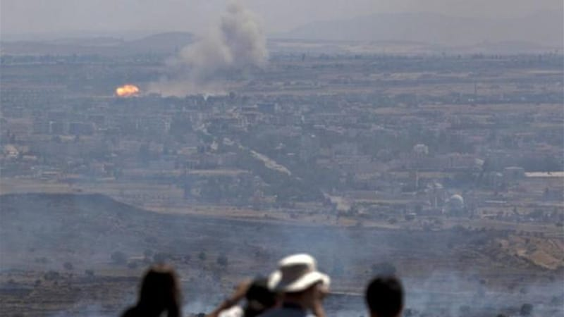 Israeli tourists have watched recent fighting inside Syria from the occupied Golan Heights [AP]