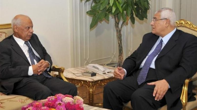Beblawi, left, an ex-finance minister, was named the new  PM by interim leader Mansour, right [Reuters]