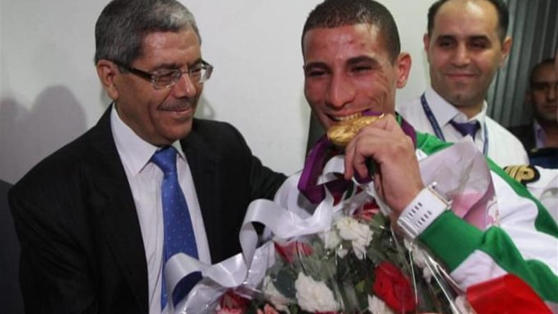 Algerian sports fans will not be able to cheer Taoufik Makhloufi (C) who won gold at London 2012 [EPA]