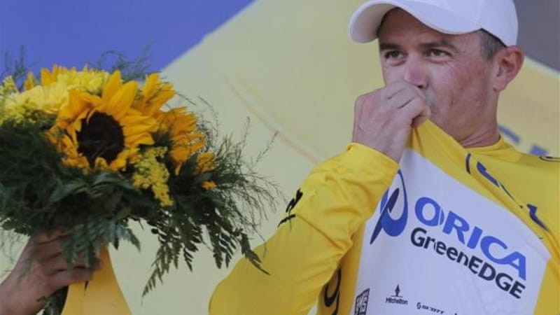 Gerrans kisses yellow jersey after his team Orica-GreenEdge win 25km time-trial around Nice [AP]