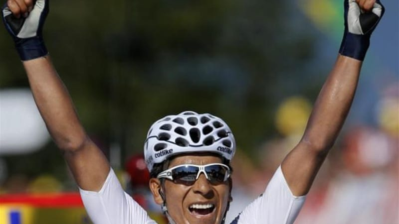 Quintana of Colombia, in the best young rider's white jersey, crosses the line to win 20th stage [AP]