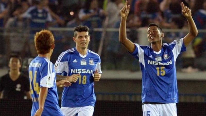 Marinos defender Fabio (R) celebrates goal during a hot and humid game against United [AFP]