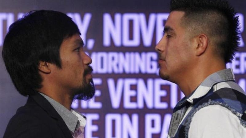Pacquiao (L) and Brandon Rios face off during news conference at Venetian Macao hotel in Macau [Reuters]
