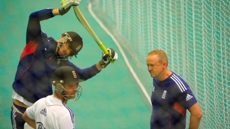A stretching Pietersen consults with coach Andy Flower (R) and Jonathan Trott during net session at Old Trafford [GETTY]