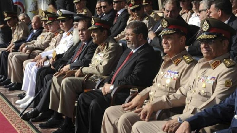 Western democracies are complicit in the de-democratisation of Egypt, and have allowed a coup to transpire because of their antipathy towards the incumbent party, the author argues [Reuters]