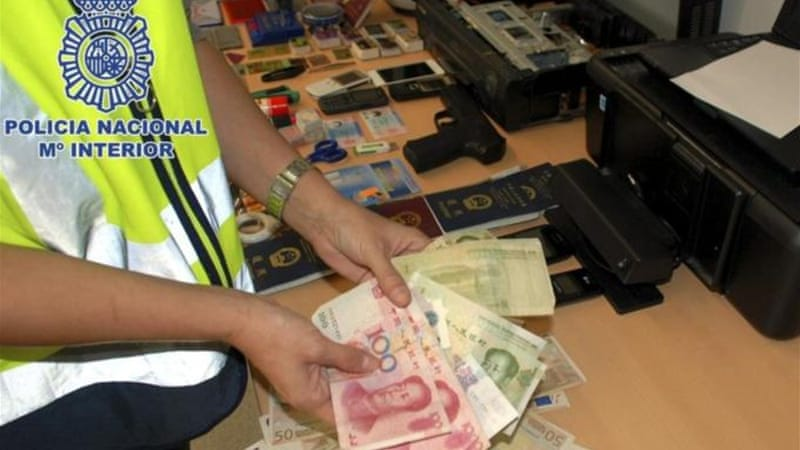 Police photographs showed seized cash, passports and weapons [EPA]