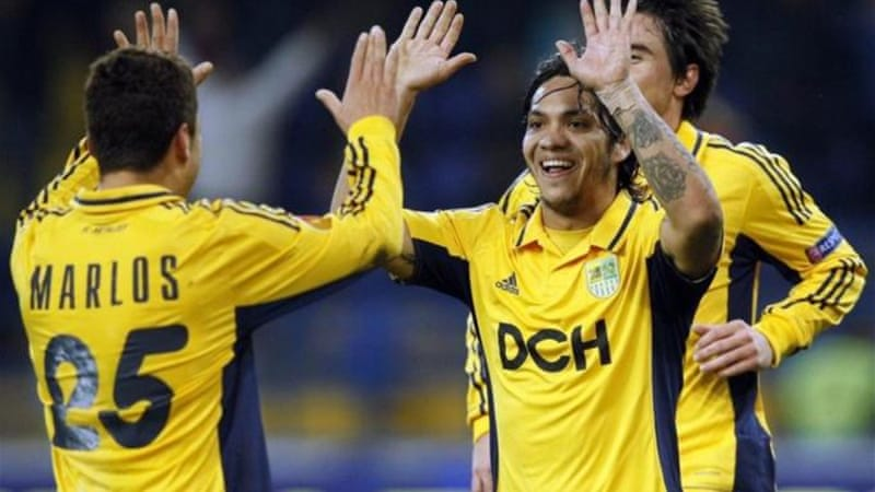 Metalist players celebrate scoring goal against Rosenborg BK during UEFA Europa League Group stages [EPA]