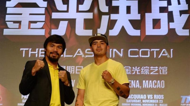 Philippine boxing icon Manny Pacquiao (L) and Brendon Rios pose for upcoming welterweight bout in Macau [AFP]