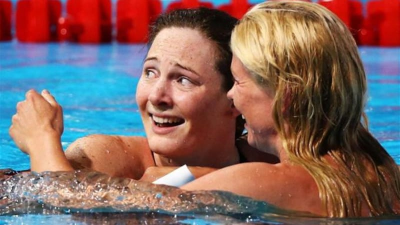 Cate Campbell (L) looks stunned as she is congratulated by Britta Steffen of Germany [GALLO/GETTY]