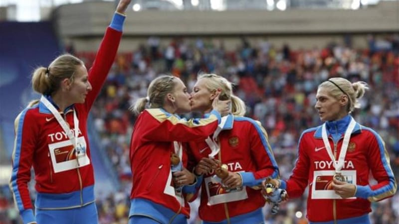 Gushchina (L) and Ryzhova celebrate with a kiss alongside Tatyana Firova and Antonina Krivoshapka [Reuters]