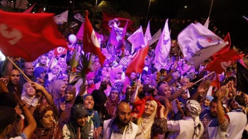 Supporters of Ennahda shouted slogans in support of the government, rejecting an opposition 'coup' [Reuters]