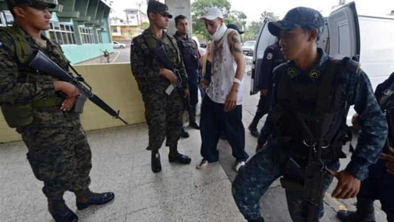 A contingent of 70 soldiers and police was sent to guard the Hospital Escuela in Tegucigalpa after the riot [AFP]