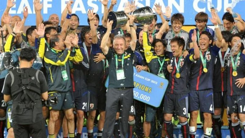 Japan coach Alberto Zaccheroni (C) celebrates East Asian Cup victory with players [AFP]