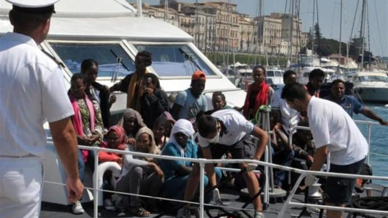 The migrants, mainly from North Africa, were rescued from a boat 39km off the Libyan coast on Sunday [EPA]