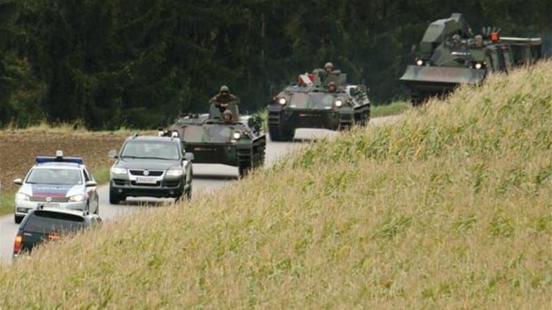 Police and army vehicles surrounded the scene of the standoff in Melk on Tuesday [Reuters]