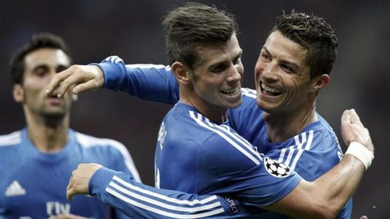 Ronaldo (R) celebrates one of his goal with new kid Gareth Bale (C) during Real Madrid's 6-1 victory on Tuesday [Reuters]