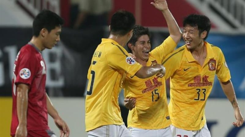 China's Guangzhou Evergrande players (pictured) will face Japan's Kashiwa Reysol in semi-finals [AFP]