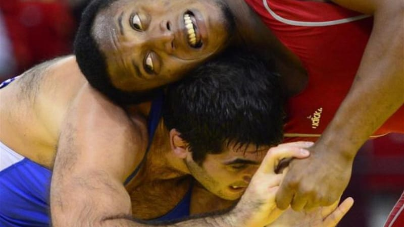 The Iranian wrestlers have refused to compete against their Israeli counterparts to the detriment of the sport, writes Brooks [AFP]