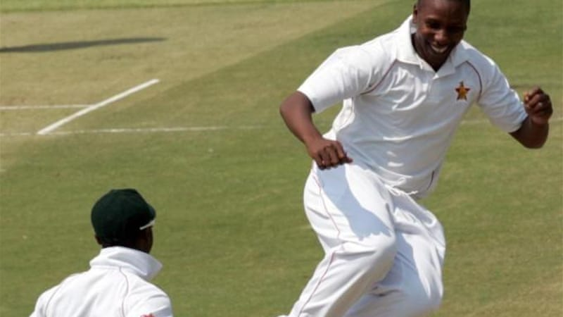 Zimbabwe bowler Tinashe Panyangara (R) returned best bowling figures of the day with 3-71 [AFP]