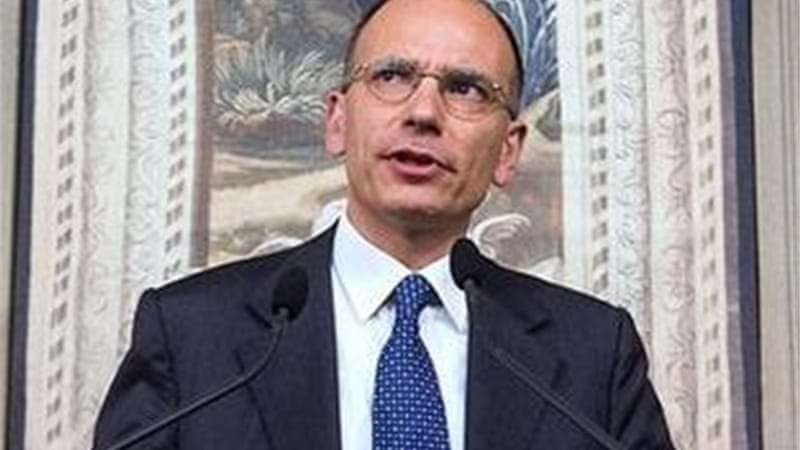 Relations between Letta's centre-left grouping and ex-PM Silvio Berlusconi's party have reached rock bottom [AP]