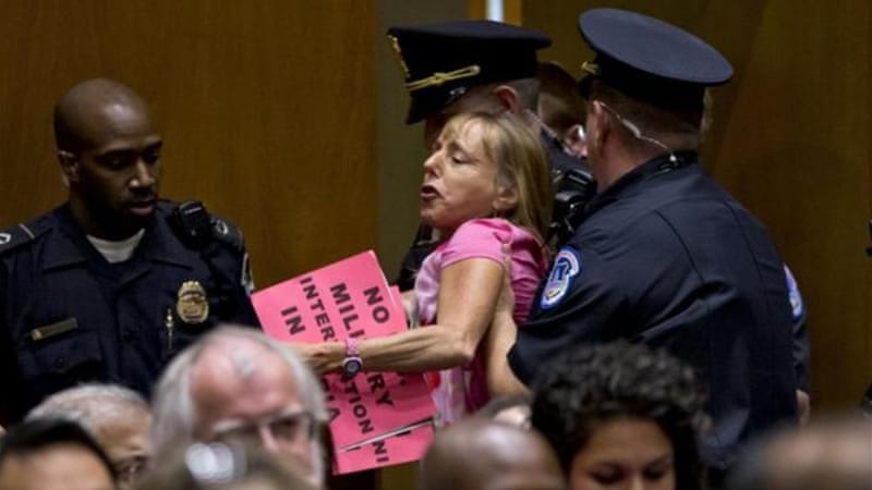 CODEPINK co-founder Medea Benjamin was removed by Capitol police during congressional hearings on Syria [AP]