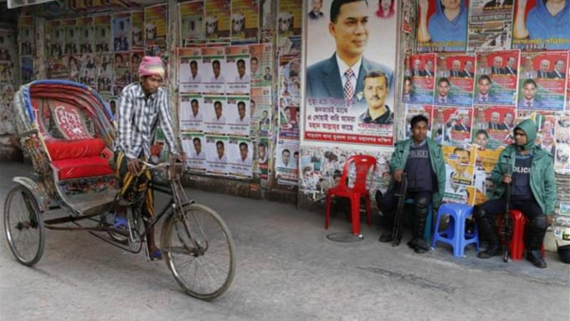 Elections in Bangladesh will proceed amid much controversy [AP]