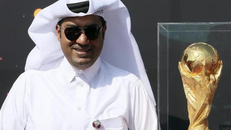A Qatari official with the World Cup trophy in Doha last year shortly after Amnesty made its criticism [Reuters]
