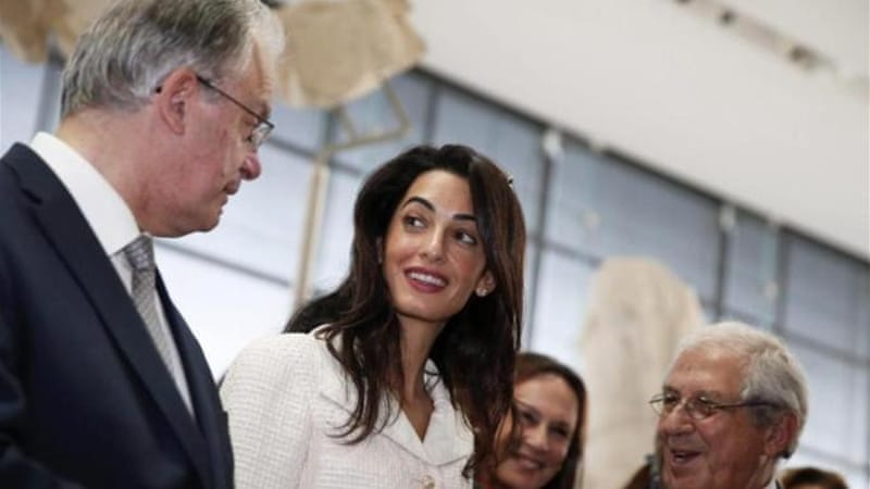 Amal Alamuddin Clooney and Greece's Minister of Culture and Sports inside the Acropolis museum [Reuters]