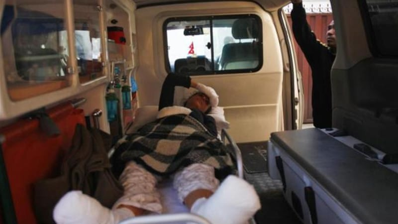 An injured avalanche victim from Israel lies inside an ambulance to head home [AP]
