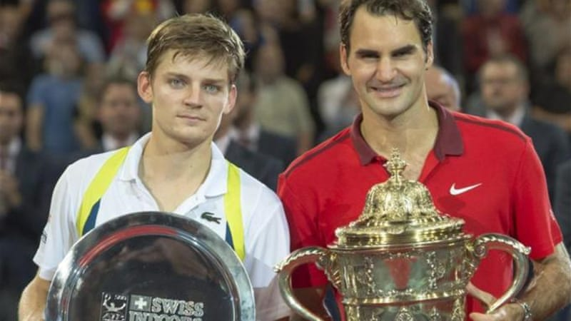 It took Federer (R) just 51 minutes to ease past Goffin in the final [EPA]
