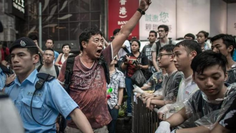 Opposition groups clashed with the protesters in one of Hong Kong's busiest shopping districts, Mong Kok [AFP]
