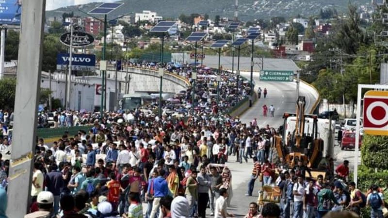 Thousands of protesters marched across Mexico on Wednesday to demand action from federal government [AFP]