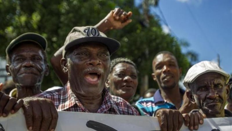 Haitian sugar cane workers demand Haitian passports needed to regularise their status in Dominican Republic [AFP]