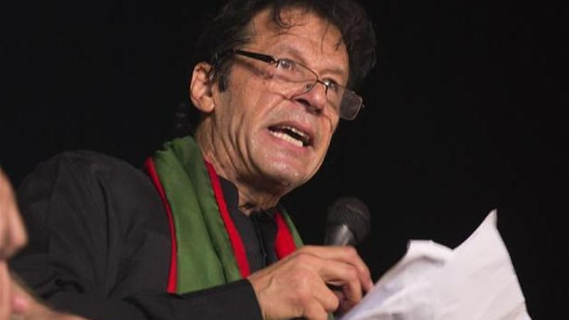 Khan is staging rallies in major cities calling for the resignation of the prime minister [AP]