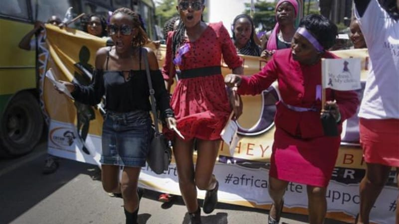 Kenyan women demonstrate in support of a woman who was stripped of her clothing by a group of men [EPA]