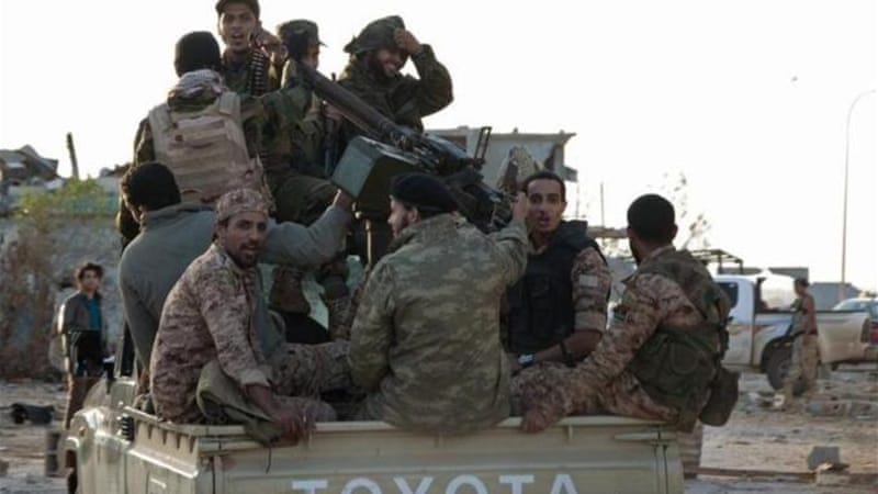 Pro-government forces are battling Islamist militiamen for control of Libya's second city [Reuters]
