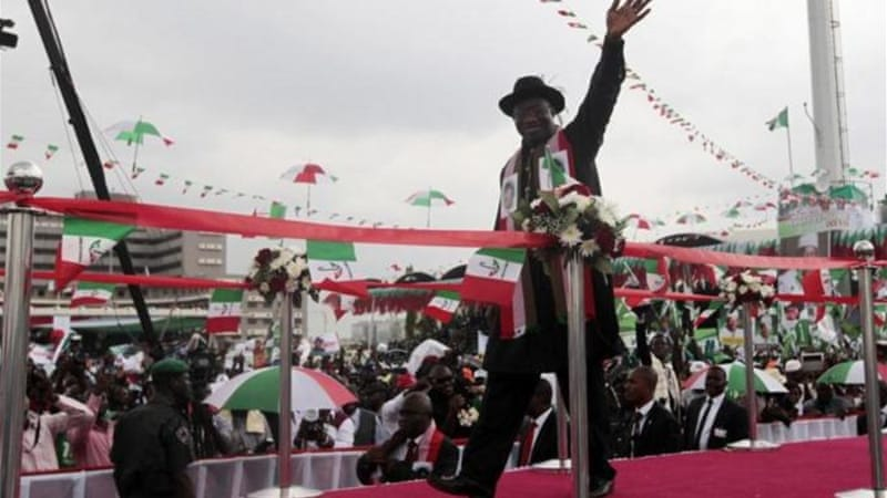 Goodluck Jonathan waves to supporters during his declaration to seek a second term [Reuters]