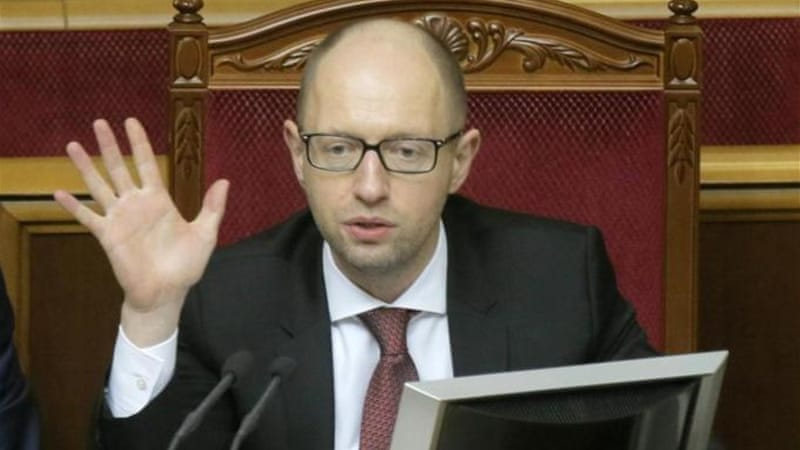 Yatsenyuk says 'terrorists' must leave Ukraine's eastern regions before financial aid resumes [AP]