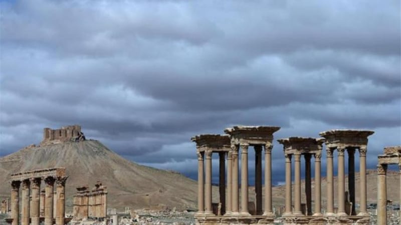 The monumental entrance of the ancient oasis city of Palmyra, northeast of Damascus [AFP]