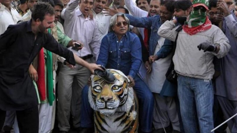 Monday's Lahore 'shutdown' is the third in a series of protests that Khan announced on November 30 [EPA]