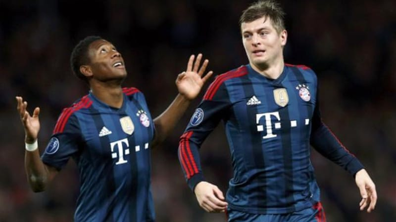 Kroos, right, celebrates his opening goal at the Emirates Stadium with David Alaba [Reuters]