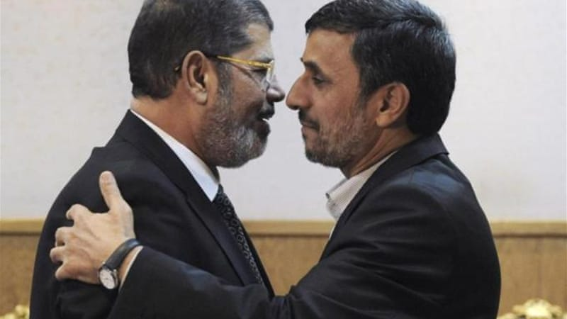 Morsi stands accused of conspiring with foreign powers, Palestinian group Hamas and Iran [AP]