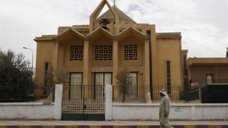 In 2013, ISIL removed crosses from The Martyrs Church in Raqqa and hoisted their flags [Reuters]