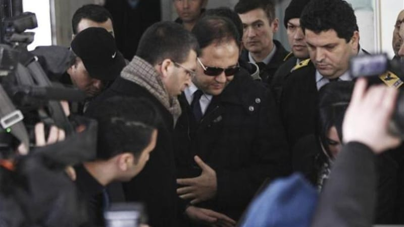 Baris Guler (in sunglasses) was among those released after the necessary evidence had been collected [Reuters]