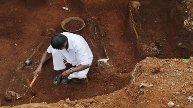 A new report suggests that the Sri Lankan army tried to cover up evidence of mass graves [AP]